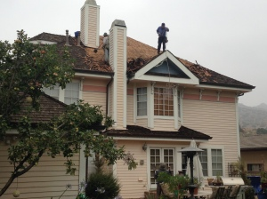 Workers starting the big project of re roofing Victorian home. Painting is next